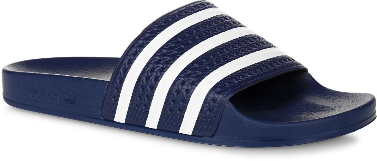 Шлепанцы мужские adidas Adilette, цвет: темно-синий, белый. 288022. Размер 12 (46)288022Шлепанцы adidas Adilette выполнены из полимера и оформлены декоративным тиснением. Подкладка из текстиля комфортна при носке. Подошва изготовлена извысококачественного легкого ЭВА-материала. Верхняя часть подошвы SUPERCLOUD PLUS обеспечивает максимальный комфорт стоп и отличную амортизацию. Поверхность подошвы дополнена рельефным рисунком.