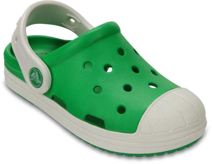 Сабо детские Crocs, цвет: зеленый. 202282-3N7. Размер C6 (23)202282-3N7Стильные сабо Bump It Clog от Crocs придутся по душе вашему ребенку. Модель полностью выполнена из полимерного материала контрастных цветов. Перфорация в верхней части обеспечивает вентиляцию ноги. Съемный пяточный ремешок, оформленный названием бренда, предназначен для фиксации стопы при ходьбе. Стелька с массажными линиями для стимуляции кровообращения и дополнительного комфорта. Рифление на подошве гарантирует идеальное сцепление с любой поверхностью. Такие сабо - отличное решение для каждодневного использования!
