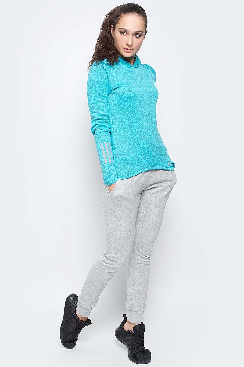Худи женское adidas Rs Astro Hood W, цвет: бирюзовый меланж. BK3159. Размер XL (52/54)BK3159Худи adidas RS ASTRO HOOD W выполнено из быстросохнущего мягкого флиса. С внутренней стороны модель дополнена теплой подкладкой. Ткань с технологией climalite® быстро и эффективно отводит влагу с поверхности кожи, поддерживая комфортный микроклимат. Худи с капюшоном и длинными рукавами оформлено светоотражающими деталями и надписью бренда. Манжеты на рукавах дополнены прорезями для больших пальцев.