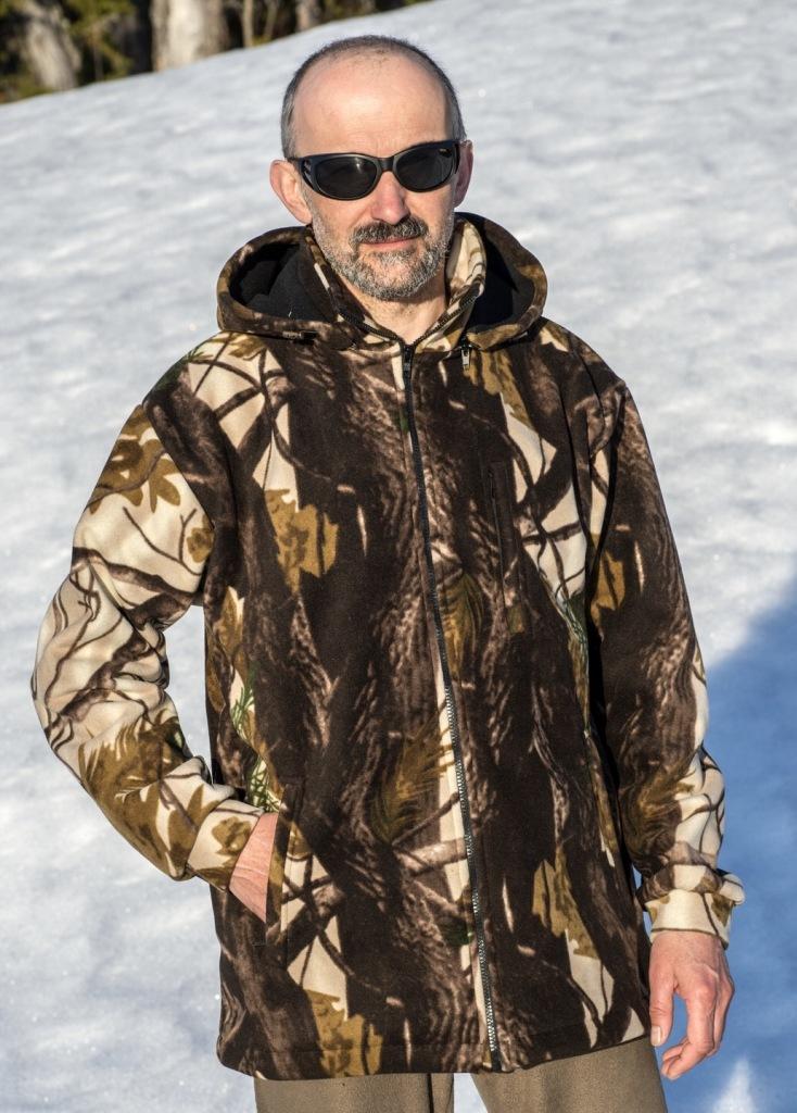 Куртка охотничья Fisherman Гризли, цвет: камуфляж. 62261. Размер 46ГризлиКуртка Гризли - теплая, не продуваемая, не промокаемая, дышащая куртка для холодной и сырой погоды. Куртка имеет высокий воротник, отстегивающийся капюшон, три наружных и один внутренний карман. Все карманы на молниях. Низ куртки и капюшон регулируются при помощи резинки и стопора. Куртка изготовлена из ткани windblock (флис+мембрана+флис) плотностью 400 г\м2. Windblock- это очень мягкая, приятная на ощупь и абсолютно не шуршащая ткань. Последний фактор, в сочетании с лесной расцветкой, делают эту куртку идеальной для охоты.