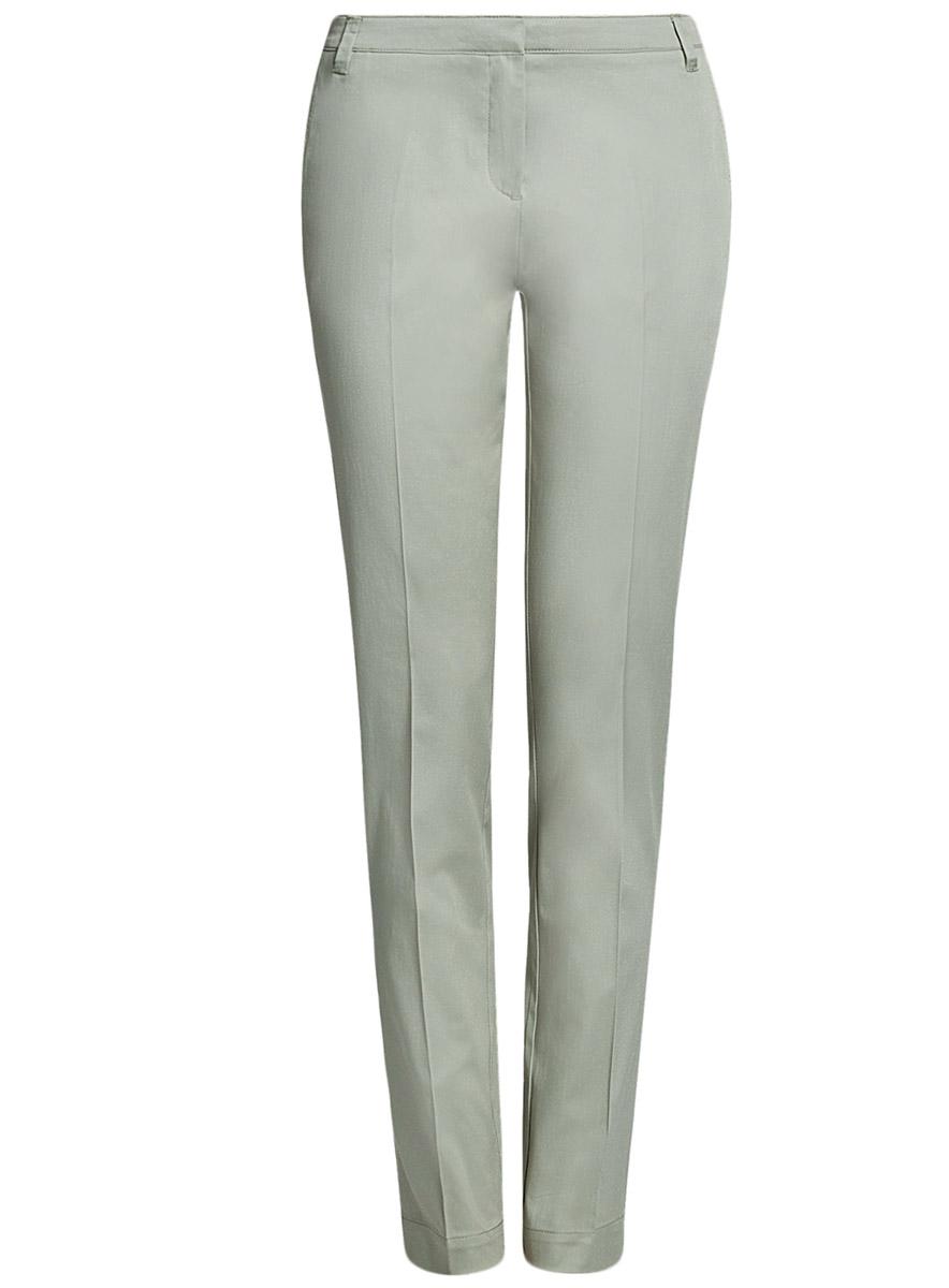 Брюки женские oodji Ultra, цвет: зеленый. 11704017B/14522/6000N. Размер 38-170 (44-170)11704017B/14522/6000NСтильные женские брюки oodji Ultra выполнены из хлопка с небольшим добавлением эластана. Модель со стандартной посадкой застегивается на молнию, пуговицу и застежку-крючок, имеются шлевки для ремня. По бокам изделие дополнено сзади имитацией прорезных карманов.