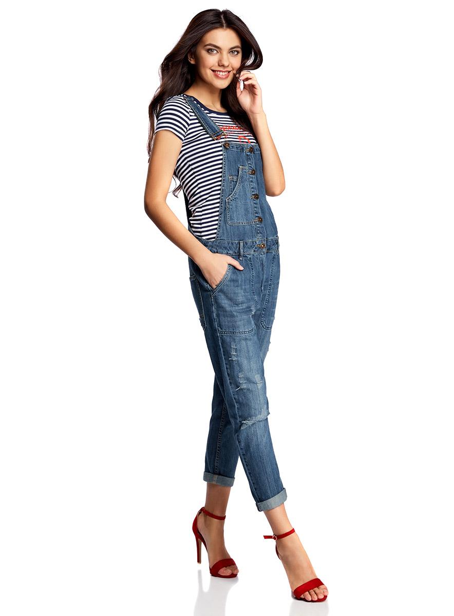 Полукомбинезон женский oodji Ultra, цвет: синий. 13108003-1/42559/7900W. Размер 42-170 (48-170)13108003-1/42559/7900WСтильный женский полукомбинезон от oodji выполнен из джинсы. Модель, декорированная эффектными потертостями, имеет широкие лямки, регулируемые по длине, застегивается на пуговицы и на молнию в ширинке.