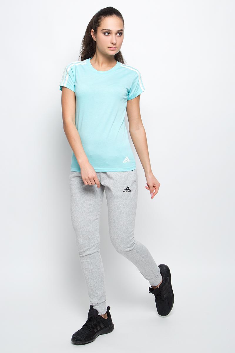 Футболка женская adidas Ess 3S Slim Tee, цвет: бирюзовый. S97185. Размер XS (40/42)S97185Спортивная женская футболка Ess 3s slim tee от adidas современного приталенного кроя выполнена из отводящей влагу тканис технологией climalite, которая поможет сохранить комфортное ощущение сухости. У модели круглый ворот, на рукавах узнаваемые три полоски. Эта модель - часть экологической программы adidas: использованы технологии, сберегающие природные ресурсы, каждая нить имеет значение, переработанный полиэстер сохраняет природные ресурсы и уменьшает отходы производства.