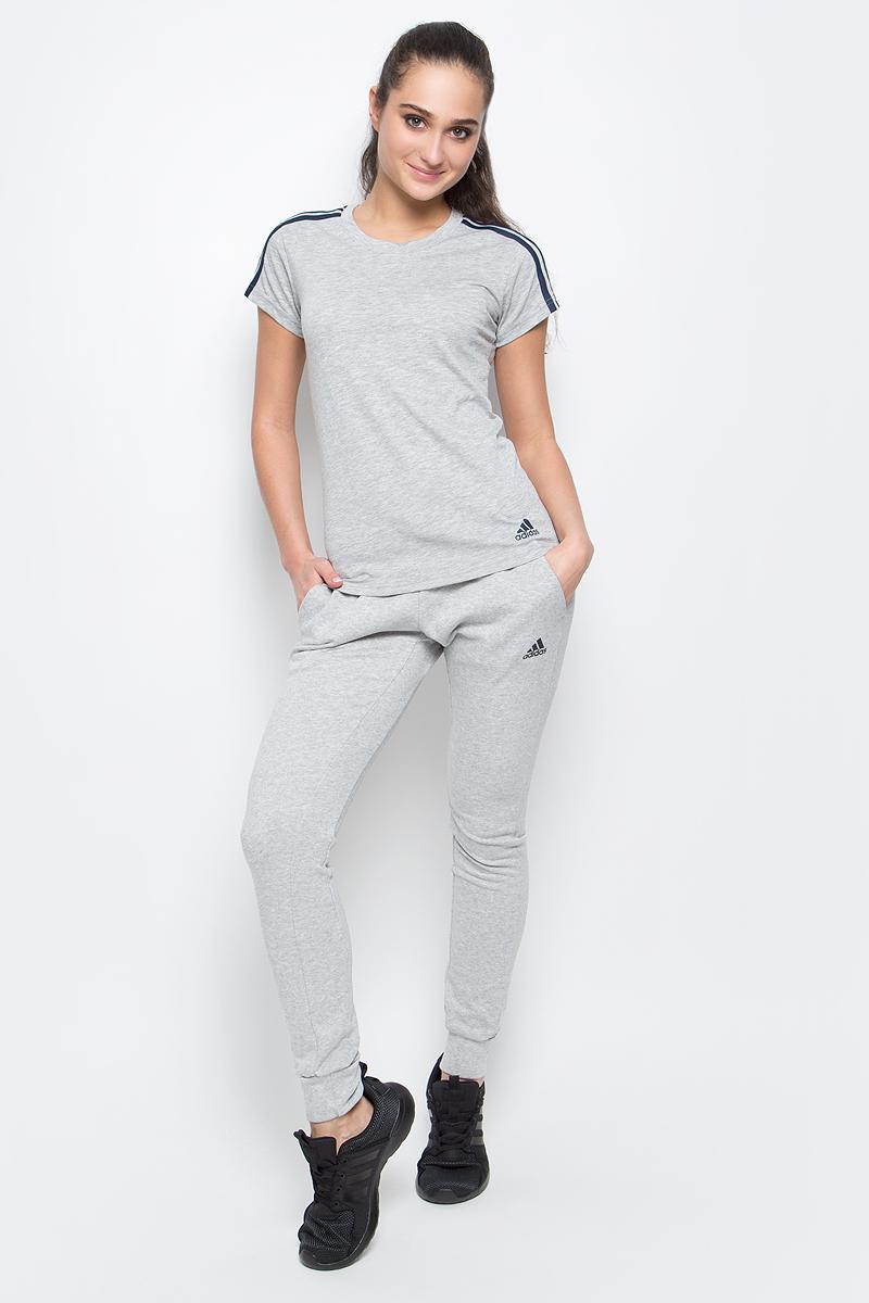 Футболка женская adidas Ess 3S Slim Tee, цвет: серый. S97186. Размер XL (52/54)S97186Спортивная женская футболка Ess 3s slim tee от adidas современного приталенного кроя выполнена из отводящей влагу тканис технологией climalite, которая поможет сохранить комфортное ощущение сухости. У модели круглый ворот, на рукавах узнаваемые три полоски. Эта модель - часть экологической программы adidas: использованы технологии, сберегающие природные ресурсы, каждая нить имеет значение, переработанный полиэстер сохраняет природные ресурсы и уменьшает отходы производства.