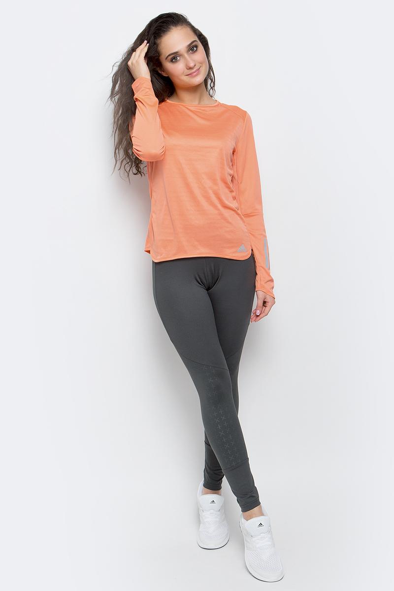 Лонгслив для бега женский adidas Rs Ls Tee W, цвет: оранжевый. BP7440. Размер L (48/50)BP7440Женский лонгслив adidas Rs Ls Tee W с круглым вырезом горловины и длинными рукавами изготовлен из полиэстера. Материал обеспечивает необходимую циркуляцию воздуха и превосходно отводит влагу от тела, оставляя кожу сухой. Лонгслив дополнен светоотражающими полосками на рукавах.