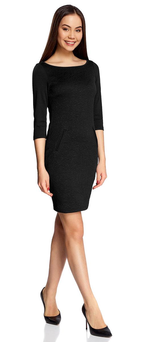Платье oodji Collection, цвет: черный. 24001100-4/46435/2900N. Размер XS (42-170)24001100-4/46435/2900NПлатье oodji Collection, выгодно подчеркивающее достоинства фигуры, выполнено из плотного фактурного трикотажа. Модель средней длины с вырезом лодочкой и рукавами 3/4 дополнена двумя прорезными карманами на юбке.