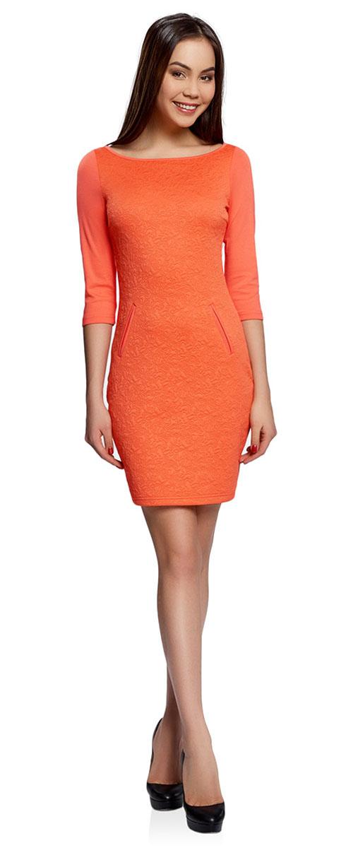 Платье oodji Collection, цвет: оранжевый. 24001100-4/46435/5500N. Размер S (44-170)24001100-4/46435/5500NПлатье oodji Collection, выгодно подчеркивающее достоинства фигуры, выполнено из плотного фактурного трикотажа. Модель средней длины с вырезом лодочкой и рукавами 3/4 дополнена двумя прорезными карманами на юбке.