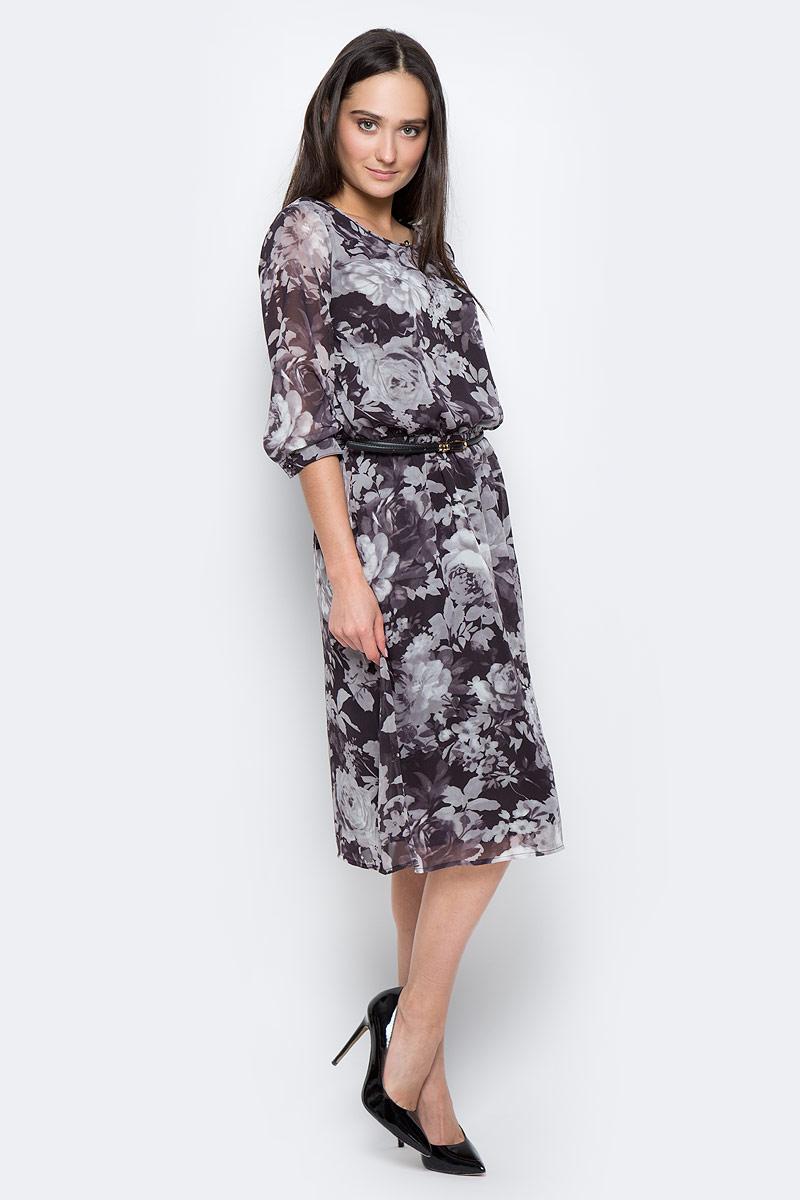 Платье Finn Flare, цвет: темно-коричневый, светло-серый. B17-11042. Размер S (44)B17-11042Стильное платье Finn Flare изготовлено из тонкого полиэстера. Модель застегивается сзади на пуговицу. Платье оформлено рисунком с крупными цветами. Талия собрана на вшитую внутреннюю резинку. Рукава дополнены манжетами, которые застегиваются на пуговицы. У модели имеется подкладка и тонкий пояс из искусственной кожи с металлической пряжкой.