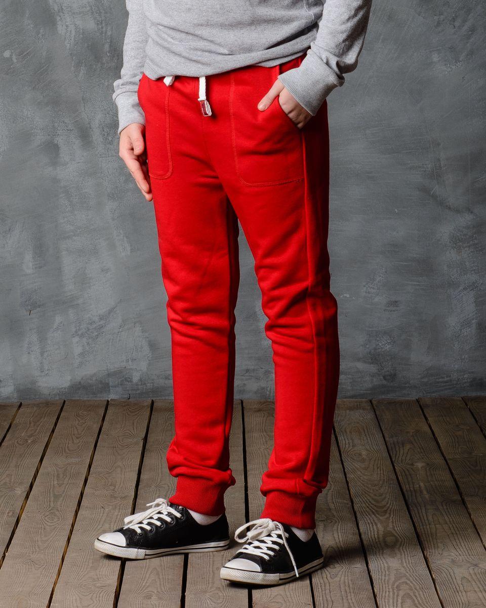 Брюки спортивные для мальчика Modniy Juk, цвет: красный. 15В00080700. Размер 122/12815В00080700/BASE/Спортивные брюки Modniy Juk изготовлены из высококачественной мягкой ткани. Модель полуприлегающего силуэта заужена к низу. Комфортный мягкий пояс и манжеты из трикотажной резинки. Брюки дополнены боковыми карманами.