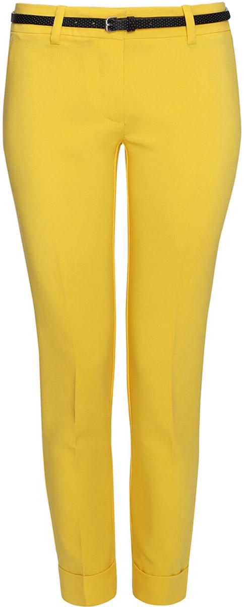 Брюки женские oodji Ultra, цвет: желтый. 11703057-5/38/5200N. Размер 44-170 (50-170)11703057-5/38/5200NЖенские брюки oodji Ultra выполнены из высококачественного материала. Модель стандартной посадки застегивается на пуговицу в поясе и ширинку на застежке-молнии. Пояс имеет шлевки для ремня. Спереди брюки дополнены втачными карманами, сзади - прорезными.