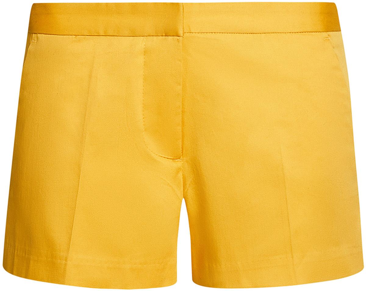 Шорты женские oodji Ultra, цвет: желтый. 11801093-1B/14522/5200N. Размер 34-170 (40-170)11801093-1B/14522/5200NЖенские шорты oodji Ultra выполнены из эластичного хлопка. Модель застегивается на молнию и крючок в поясе. Спереди модель дополнена втачными карманами, сзади - имитацией прорезных карманов. Оформлено изделие стрелками.