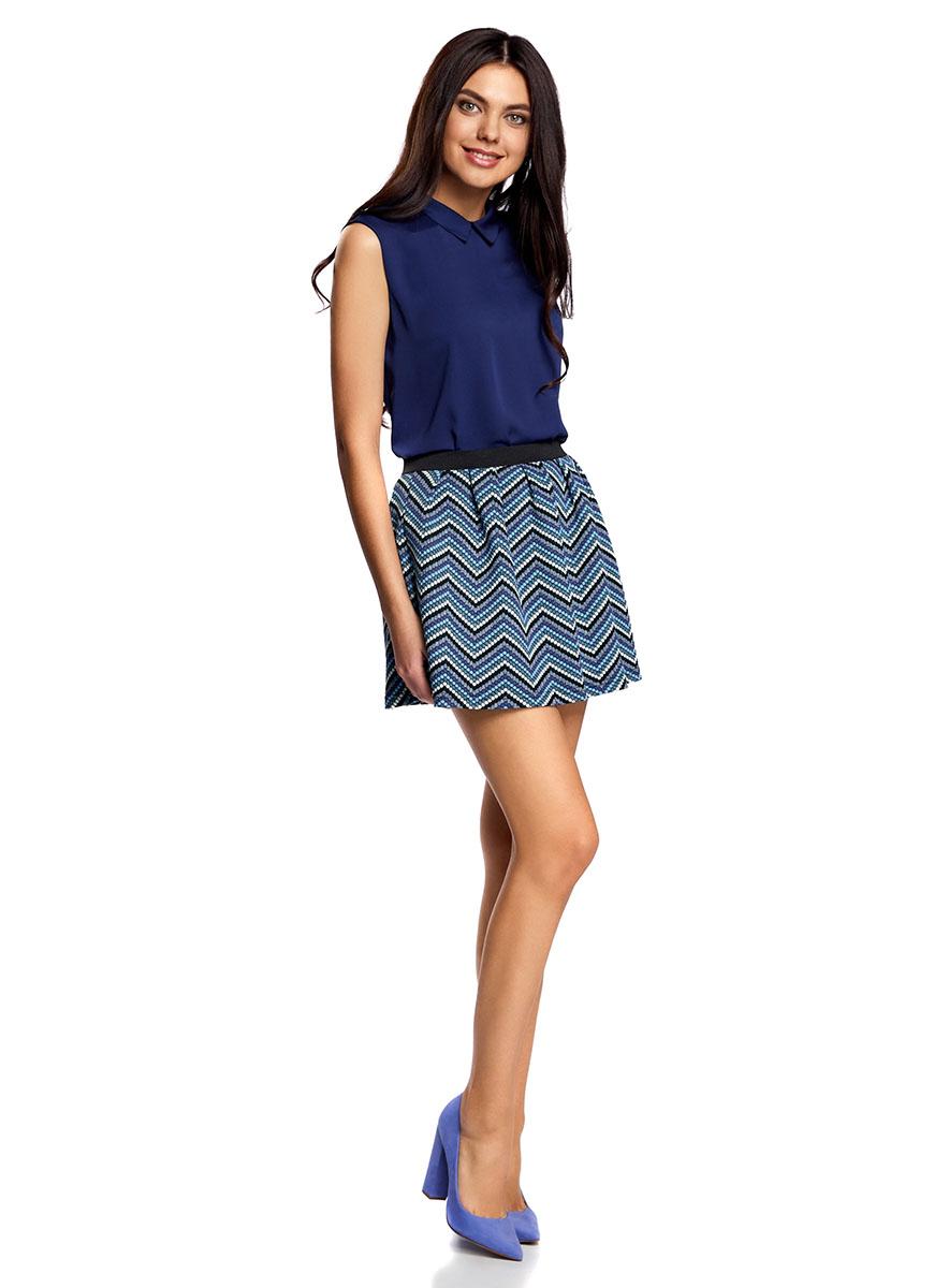 Юбка oodji Ultra, цвет: черный, синий. 14100019-4/46478/2975S. Размер L (48)14100019-4/46478/2975SРасклешенная мини-юбка выполнена из фактурной ткани. Сзади юбка застегивается на металлическую застежку-молнию.