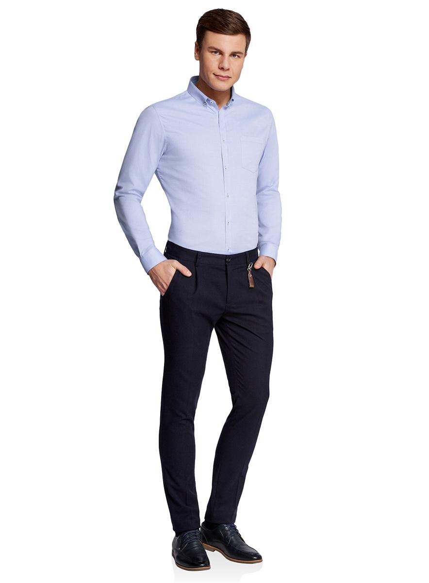Рубашка мужская oodji Basic, цвет: голубой. 3B110007M/34714N/7000O. Размер 44-182 (56-182)3B110007M/34714N/7000OМужская рубашка oodji, выполненная из натурального хлопка, застегивается на пуговицы. Модель приталенного силуэта с длинными рукавами, закругленным низом и отложным воротничком баттен-даун имеет слева на груди карман. Воротник с пуговицами на углах придает рубашке элегантности. Натуральный хлопок приятен на ощупь, не раздражает кожу, дышит.