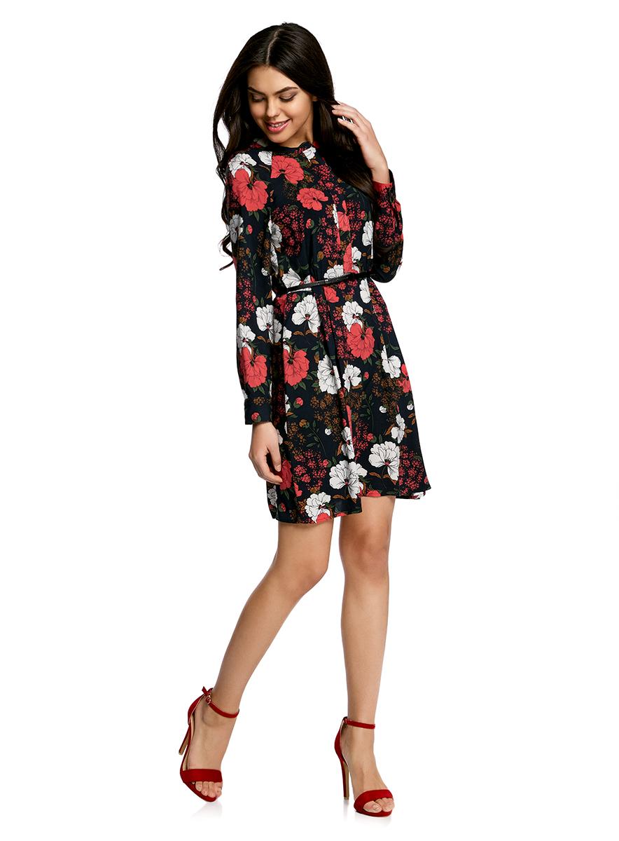 Платье oodji Collection, цвет: черный, красный. 21912001-2/26346/2945F. Размер 36-170 (42-170)21912001-2/26346/2945FПлатье oodji Collection свободного кроя выполнено из легкой воздушной ткани с оригинальным цветочным узором. Модель средней длины с круглым вырезом горловины и длинными рукавами-реглан застегивается спереди и на манжетах на пуговицы; сбоку имеется скрытая застежка-молния.В комплект с платьемвходит узкий ремень из искусственной кожи с металлической пряжкой.