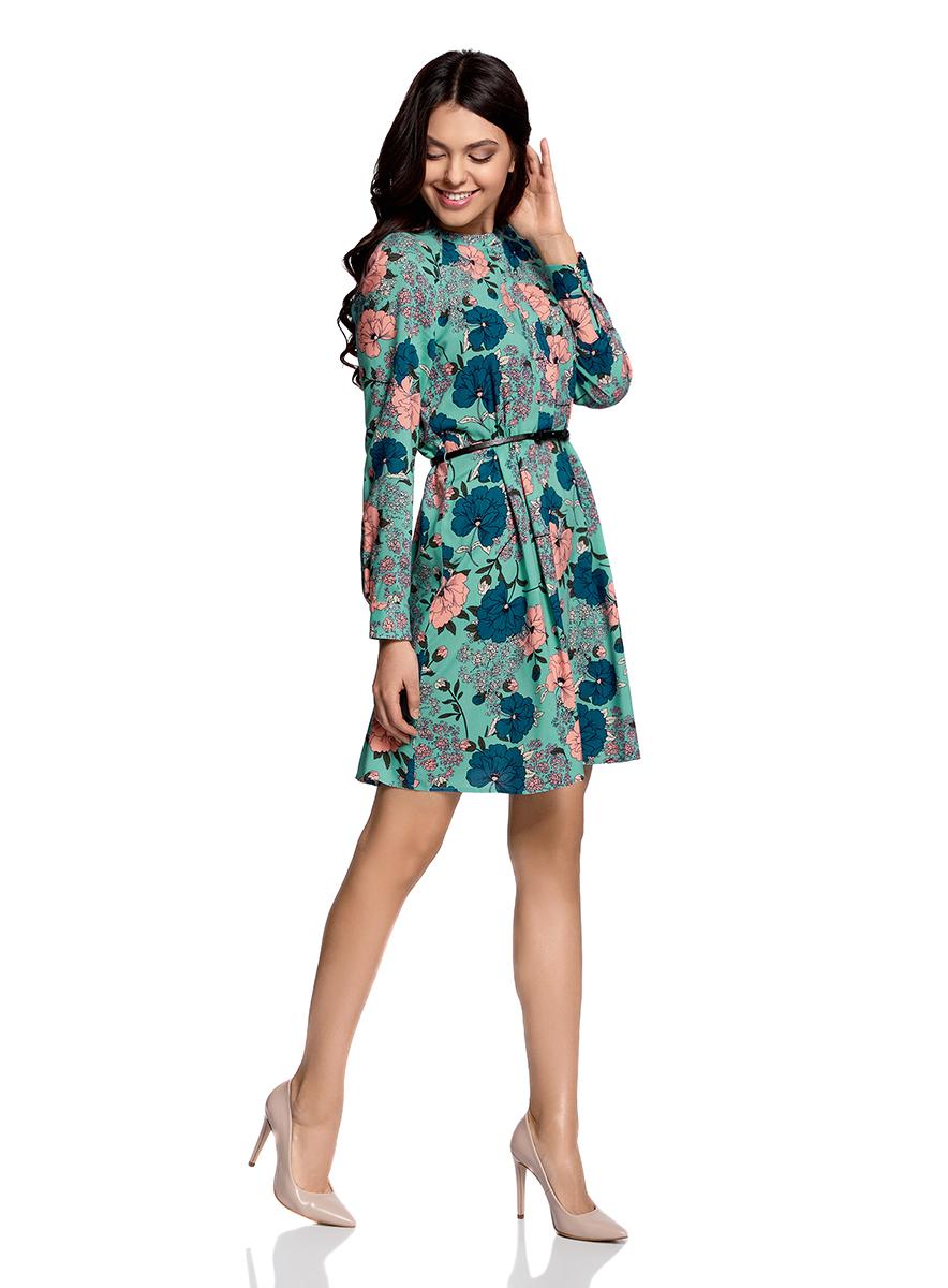Платье oodji Collection, цвет: изумрудный, розовый. 21912001-2/26346/6D41F. Размер 36-170 (42-170)21912001-2/26346/6D41FПлатье oodji Collection свободного кроя выполнено из легкой воздушной ткани с оригинальным цветочным узором. Модель средней длины с круглым вырезом горловины и длинными рукавами-реглан застегивается спереди и на манжетах на пуговицы; сбоку имеется скрытая застежка-молния.В комплект с платьемвходит узкий ремень из искусственной кожи с металлической пряжкой.