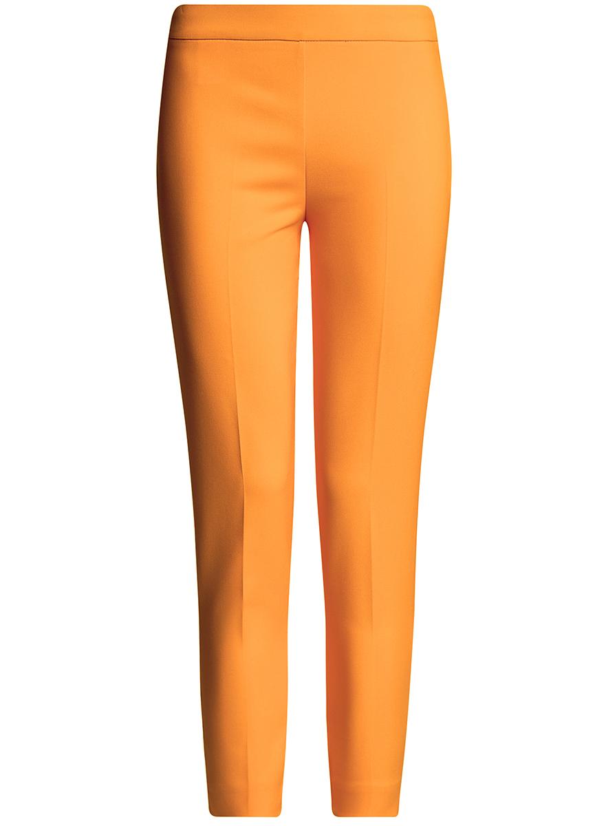 Брюки женские oodji Ultra, цвет: оранжевый. 11703095/33574/5500N. Размер 34-170 (40-170)11703095/33574/5500NЖенские укороченные брюки oodji Ultra выполнены из высококачественного материала. Зауженная модель стандартной посадки застегивается сбоку на застежку-молнию.