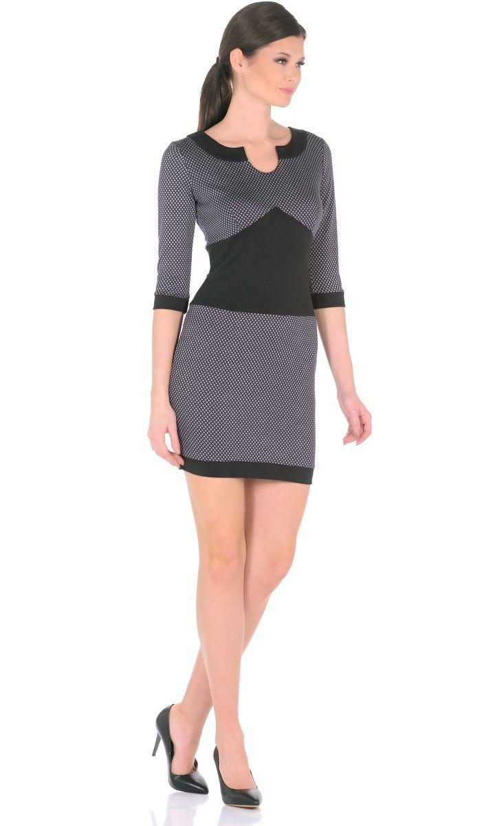 Платье Rosa Blanco, цвет: черный. 3184-К1. Размер 463184-К1Модное платье Rosa Blanco станет отличным дополнением к вашему гардеробу. Модель изготовлена из сочетания качественных материалов. Платье длины мини выполнено с оригинальным круглым вырезом горловины, который переходит в капельку. Короткие рукава 3/4 придают изделию особое изящество. Модель не имеет застежек. Платье приобретает особый шарм благодаря вставкам из контрастной ткани.