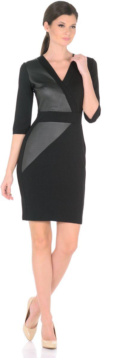 Платье Rosa Blanco, цвет: черный. 3189-А1-1. Размер 483189-А1-1Элегантное платье Rosa Blanco станет отличным дополнением к вашему гардеробу. Модель изготовлена из сочетания качественных материалов. Платье-миди с юбкой-футляр выполнено с оригинальным V-образным вырезом горловины и короткими рукавами 3/4. Модель имеет потайную застежку-молнию на спинке. Эффектные вставки из искусственной кожи придают элегантной классической модели дерзкий современный вид. Задняя сторона юбки оформлена небольшой шлицей.