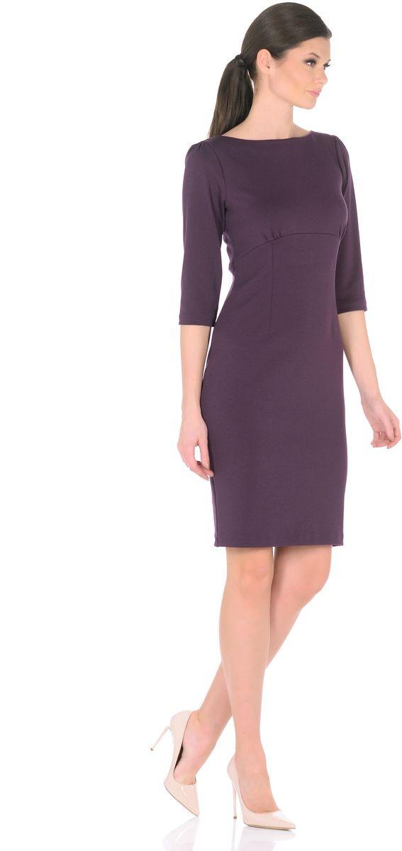 Платье Rosa Blanco, цвет: фиолетовый. 3193-14. Размер 483193-14Модное платье Rosa Blanco станет отличным дополнением к вашему гардеробу. Модель изготовлена из сочетания качественных материалов. Платье-миди выполнено с удобным приталенным силуэтом и рукавами 3/4. Изделие имеет круглый вырез горловины и застегивается сзади по спинке на пуговицу. Платье оформлено вытачками, которые выделяют талию и изгибы силуэта, а специальный подрез под грудью со сборкой заботится об оптимальной посадке.