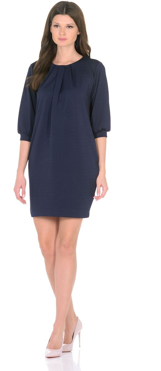 Платье Rosa Blanco, цвет: темно-синий. 3285-3. Размер 483285-3Модное платье Rosa Blanco станет отличным дополнением к вашему гардеробу. Модель изготовлена из сочетания качественных материалов. Платье-миди прямого кроя и рукавами 3/4 имеет круглый вырез горловины. Модель без застежек. Платье приобретает особый шарм за счет стильных складок у горловины и на рукавах. В боковых швах изделие дополнено двумя втачными карманами.