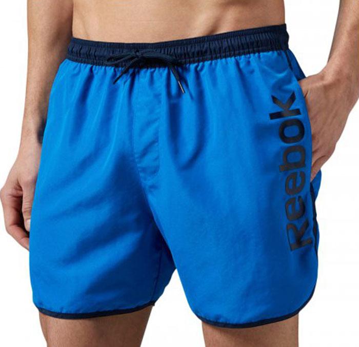 Шорты мужские Reebok Retro, цвет: синий. BK4738. Размер M (48/50)BK4738Спортивные шорты Reebok Retro выполнены из высококачественного материала. Модель дополнена внутренним карманом и поясом на шнурке, что делает эти шорты особенно функциональными. Классический крой - шорты не слишком тесные и не слишком свободные. Отлично подходят для тренировок и повседневной носки.Мягкий трафаретный принт ручной работы, расположенный сбоку, сделает ваш образ еще более спортивным.