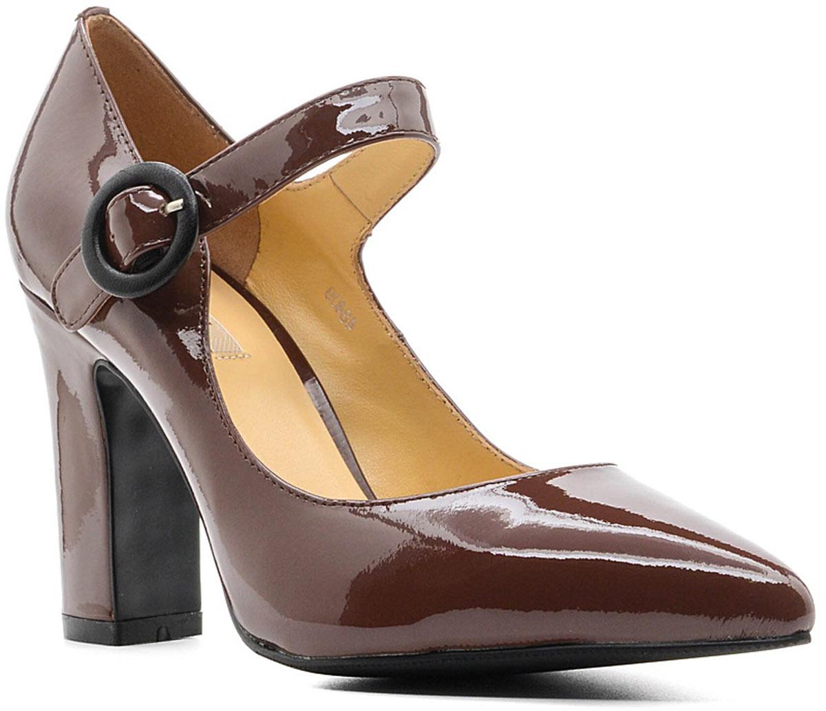 Туфли женские Vitacci, цвет: мокко. 48409. Размер 3948409Стильные туфли Vitacci не оставят вас незамеченной! Модель выполнена из качественной натуральной кожи. Ремешок с пряжкой надежно зафиксирует модель на ноге. Стелька из натуральной кожи обеспечивает комфорт и удобство при ходьбе. Подошва выполнена с высоким устойчивым каблуком.