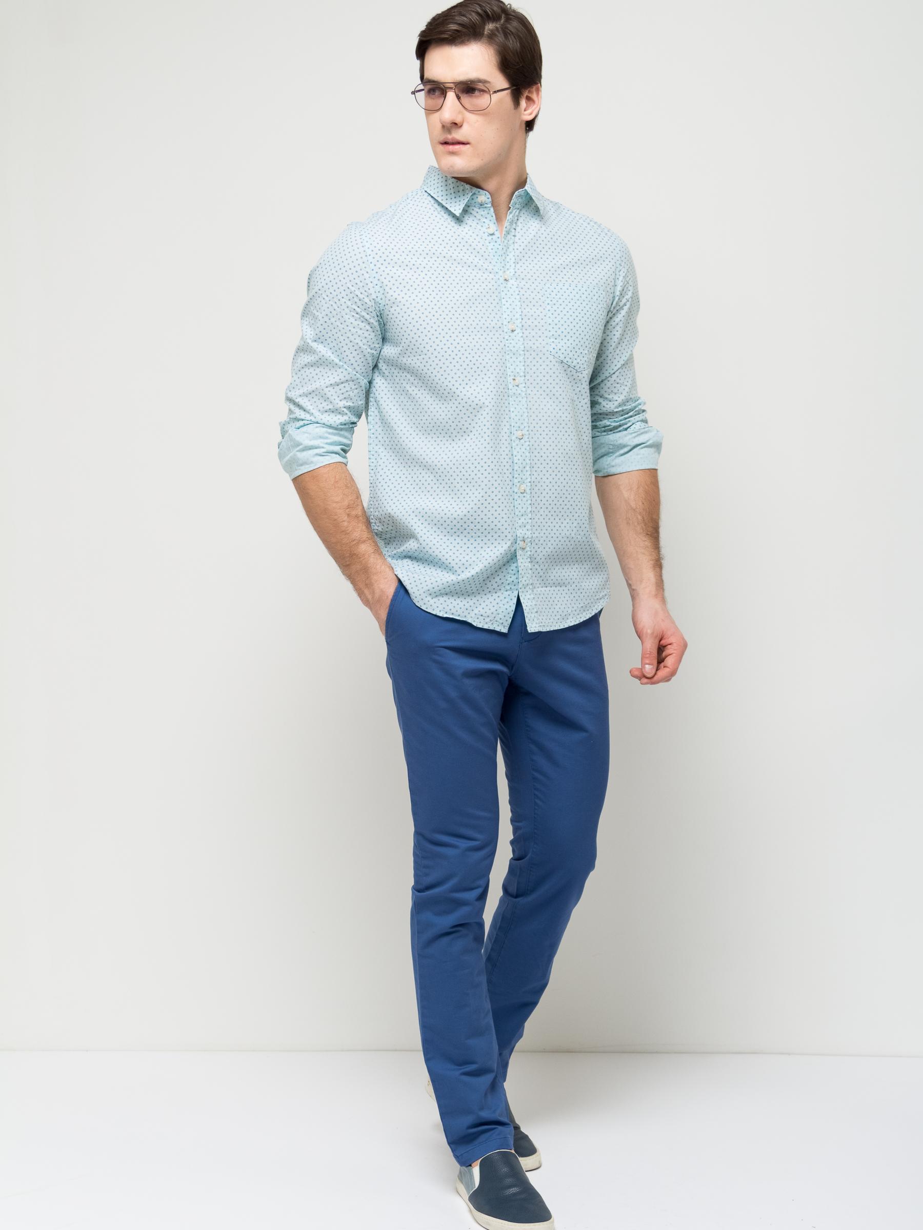 Рубашка мужская Sela, цвет: дымчатый ментол. H-212/749-7112. Размер 43 (50)H-212/749-7112Стильная мужская рубашка Sela выполнена из натурального хлопка и оформлена принтом в мелкий горошек. Модель полуприлегающего кроя с длинными рукавами и отложным воротничком застегивается на пуговицы и дополнена накладным карманом на груди. Манжеты рукавов также дополнены пуговицами.Яркий цвет модели позволяет создавать стильные образы.