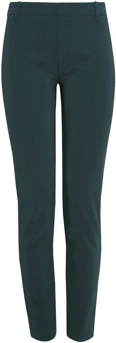 Брюки женские oodji Ultra, цвет: темно-зеленый. 11700209/42250/6900N. Размер 36-170 (42-170)11700209/42250/6900NСтильные женские брюки oodji Ultra изготовлены из качественного полиэстера с добавлением эластана. Модель-слим со стандартной посадкой выполнена в лаконичном стиле. Застегиваются брюки по боковому шву на металлическую молнию. Сзади изделие оформлено имитацией прорезных карманов, а в поясе имеет шлевки для ремня.