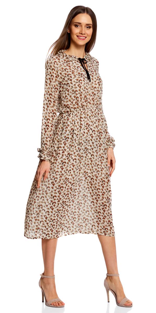 Платье oodji Ultra, цвет: бежевый, терракотовый. 11913036/38375/3331A. Размер 38-170 (44-170)11913036/38375/3331AЯркое платье oodji Ultra полуприлегющего кроя выполнено из легкой струящейся ткани и оформлено принтом с бабочками. Модель миди-длины с длинными рукавами имеет вшитую резинку на талии для лучшей посадки по фигуре и V-образный вырез горловины, дополненный завязками. Ворот и манжеты рукавов оформлены рюшами.