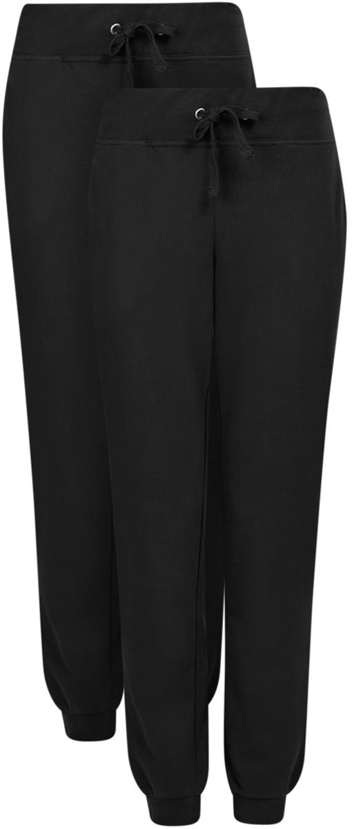 Брюки спортивные женские oodji Ultra, цвет: черный, 2 шт. 16700030-15T2/46173/2900N. Размер S (44)16700030-15T2/46173/2900NЖенские спортивные брюки oodji Ultra, выполненные из натурального хлопка, великолепно подойдут для отдыха и занятий спортом. Модель дополнена широкими эластичными резинками на поясе и по низу брючин. Объем талии регулируется с внешней стороны при помощи шнурка-кулиски. Спереди имеются два втачных кармана. В комплекте две пары спортивных брюк.