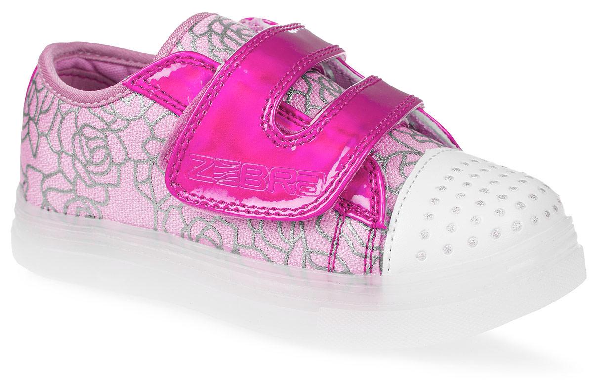 Кеды для девочки Зебра, цвет: розовый. 11596-9. Размер 2811596-9Кеды для девочки от Зебра выполнены из высококачественного текстиля. На ноге модель фиксируется с помощью застежки-липучки. Внутренняя поверхность из текстиля комфортна при движении. Стелька выполнена из натуральной кожи, и дополнена супинатором, который обеспечивает правильное положение ноги ребенка при ходьбе, предотвращает плоскостопие. Мигающая подошва изготовлена из термопластичного полимера.