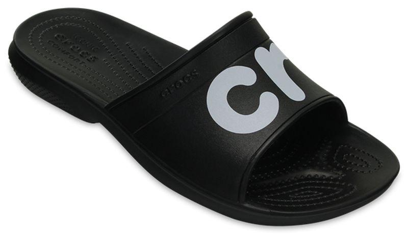 Шлепанцы мужские Crocs Classic Graphic Slide, цвет: черный. 204465-066. Размер 7-9 (39/40 )204465-066Комфортные шлепанцы из уникального инновационного полимера Croslite™. Материал под воздействием температуры тела позволяет обуви принимать форму ноги и повышает её ортопедические характеристики. Подошва имеет рельефный протектор, который обеспечивает надежное сцепление с поверхностью.