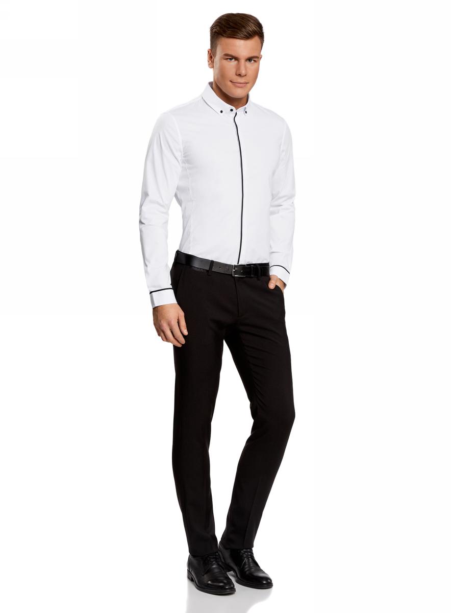 Рубашка мужская oodji Lab, цвет: белый, черный. 3L140108M/34146N/1029B. Размер 41-182 (50-182)3L140108M/34146N/1029BМужская базовая рубашка от oodji выполнена из хлопкового материала. Модель приталенного кроя с контрастной отделкой и длинными рукавами застегивается на пуговицы.