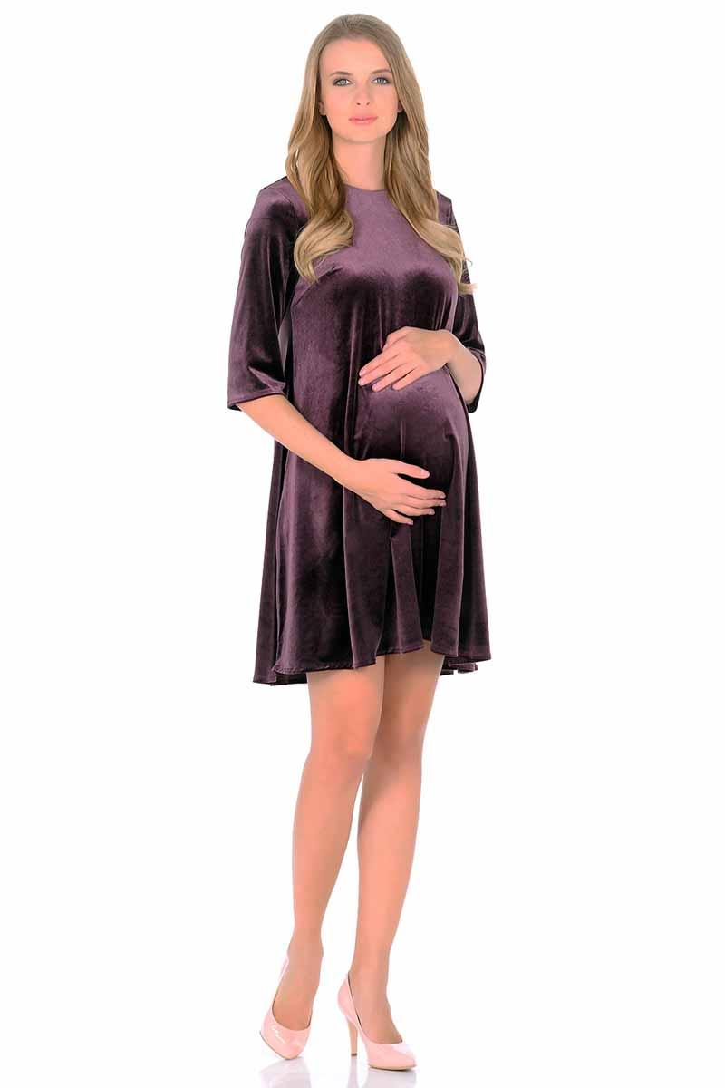Платье для беременных и кормящих Nuova Vita, цвет: темно-фиолетовый. 2160.04. Размер 442160.04Удобное бархатное платье с укороченным рукавом для беременных будет прекрасным вариантом для вашей коллекции. Этот товар станет приятной покупкой или презентом родным. Платье великолепно подойдет под любой стиль одежды. Продукт сделан из качественных материалов приятного окраса. Дизайн тщательно проработан. Все части аккуратно выбраны и хорошо смотрятся друг с другом.