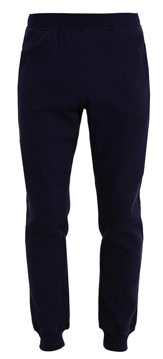 Брюки спортивные мужские Sela, цвет: темно-синий. Pk-415/009-7161. Размер S (46)Pk-415/009-7161Стильные мужские брюки-джоггеры Sela выполнены из качественного хлопкового материала и дополнены двумя втачными карманами. Брюки полуприлегающего кроя и стандартной посадки на талии имеют широкий пояс на мягкой резинке. Низ брючин дополнен мягкими трикотажными манжетами.