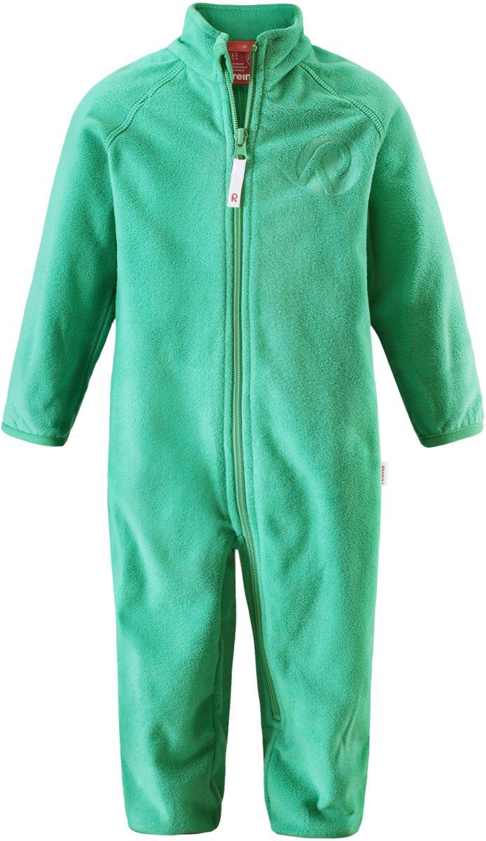 Комбинезон флисовый детский Reima Kiesu, цвет: зеленый. 5162878800. Размер 745162878800Комбинезон для малышей изготовлен из высококачественного флиса - теплого, легкого и быстросохнущего материала. Комбинезон совместим с одеждой из серии Play Layers его можно пристегнуть к комбинезонам, оснащенным кнопками Play Layers. Зимой он будет самой удобной одеждой промежуточного слоя, а в теплое время года послужит отличной верхней одеждой. Молния во всю длину поможет вам легко одеть вашего ребенка в этот теплый и удобный флисовый комбинезон.