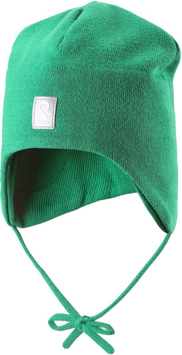 Шапка детская Reima Aqueous, цвет: зеленый. 5183958800. Размер 465183958800Вязаная шапочка для малышей подходит на все случаи жизни. Благодаря классическому дизайну, она отлично сочетается с различными вариантами одежды. Полуподкладка из хлопчатобумажного трикотажа гарантирует тепло, а ветронепроницаемые вставки между верхним слоем и подкладкой защищают уши. Осенью рано темнеет, поэтому светоотражающие детали обеспечат дополнительную безопасность.