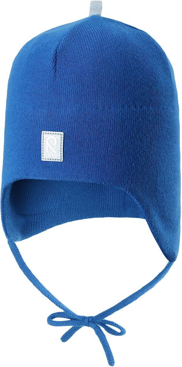 Шапка детская Reima Aqueous, цвет: синий. 5183930. Размер 505183930Вязаная шапочка для малышей подходит на все случаи жизни. Благодаря классическому дизайну, она отлично сочетается с различными вариантами одежды. Полуподкладка из хлопчатобумажного трикотажа гарантирует тепло, а ветронепроницаемые вставки между верхним слоем и подкладкой защищают уши. Осенью рано темнеет, поэтому светоотражающие детали обеспечат дополнительную безопасность.