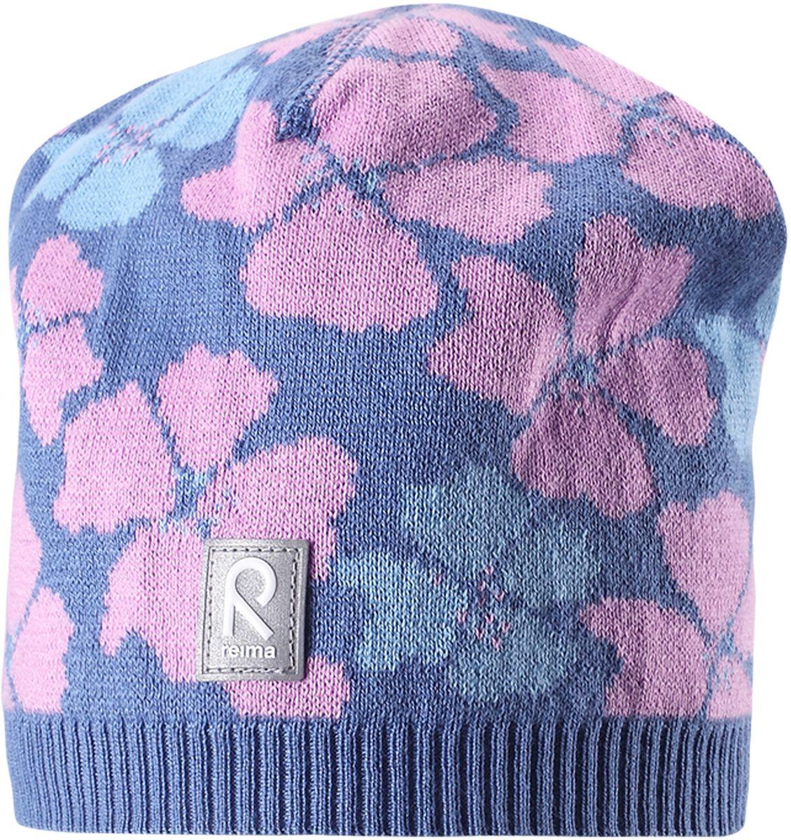 Шапка для девочки Reima Paradise, цвет: синий. 5285236550. Размер 545285236550Удобная детская шапка яркой расцветки рассчитана на межсезонье, в ней можно и поиграть во дворе, и прогуляться по городу. Она изготовлена из мягкого и комфортного вязаного хлопка. Эта облегченная модель без подкладки идеально подходит для солнечной погоды. Яркий сплошной жаккардовый узор будет отлично смотреться.