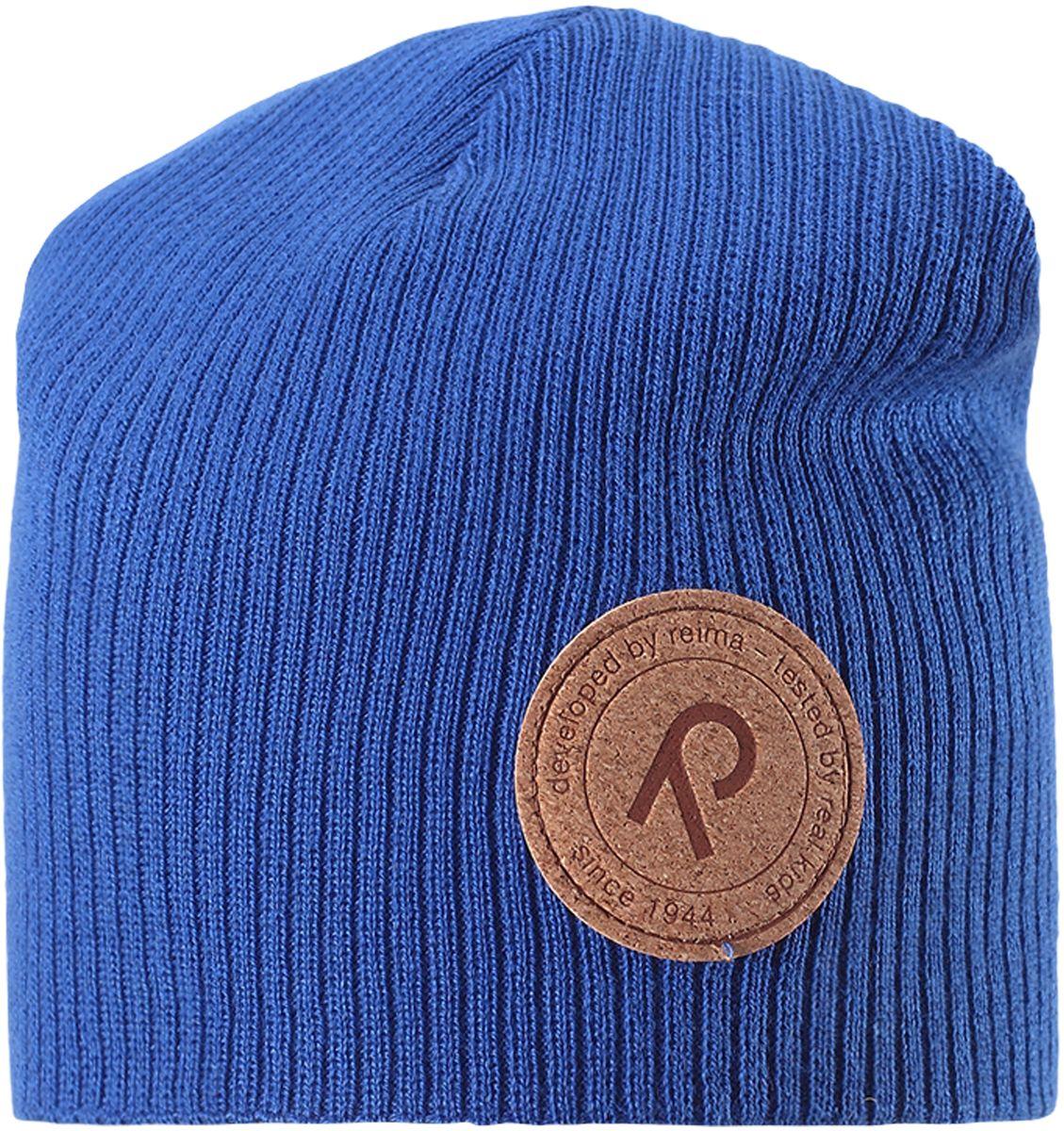 Шапка детская Reima Majakka, цвет: синий. 5285266530. Размер 505285266530Детская шапка прекрасно подойдет для весенней поры. Она изготовлена из эластичного и легкого вязаного хлопка, мягкого и приятного на ощупь. Материал сертифицирован по стандарту Oeko-Tex. Удлиненная модель с подкладкой. Шапка смотрится ярко и стильно то, что надо для прогулки!