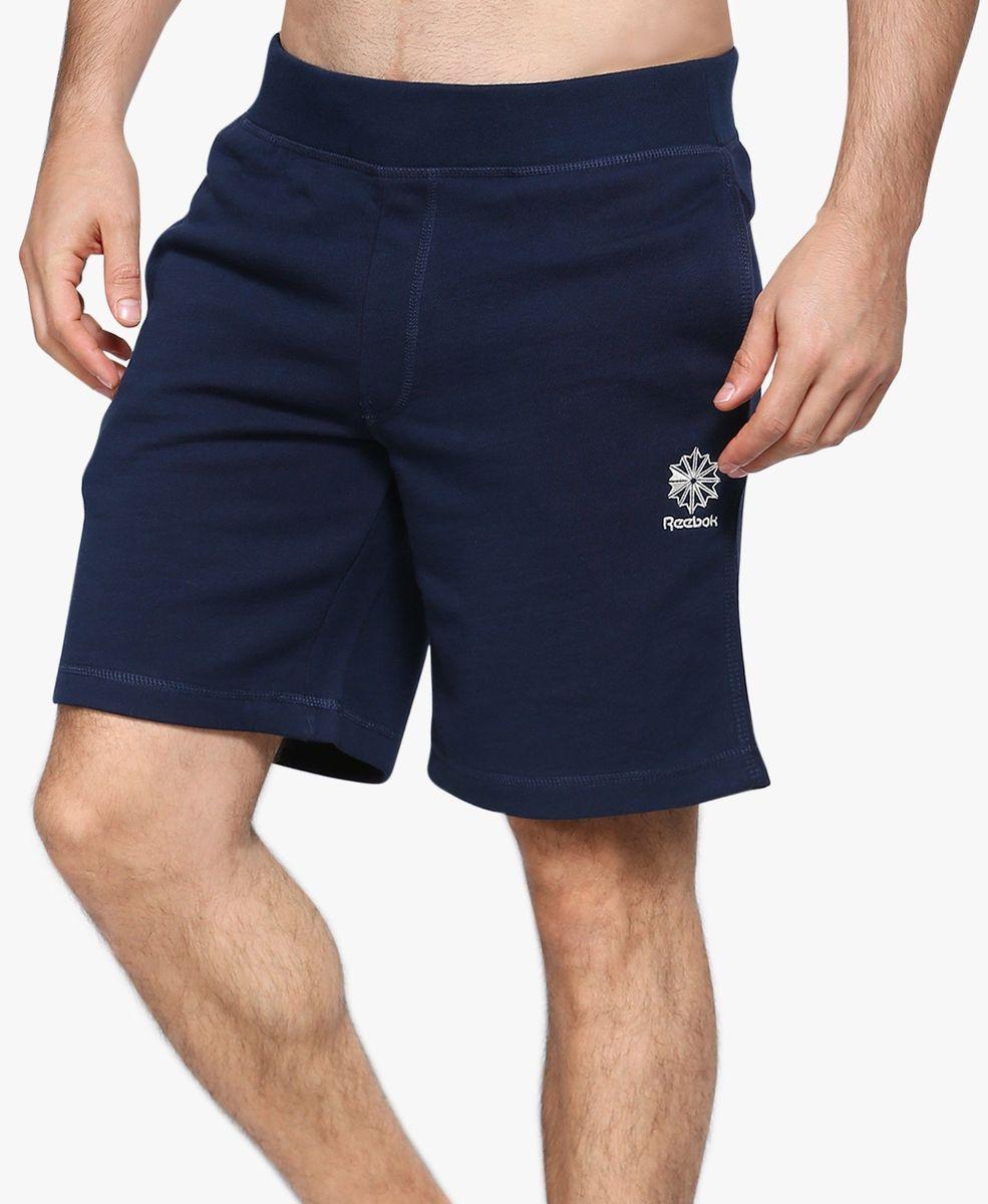 Шорты мужские Reebok, цвет: темно-синий. BK4938. Размер S (44/46)BK4938Мужские шорты Reebok F Ft Short выполнены из высококачественного материала. Классический крой - шорты не слишком тесные и не слишком свободные. Отлично подходит для тренировок и повседневной носки.