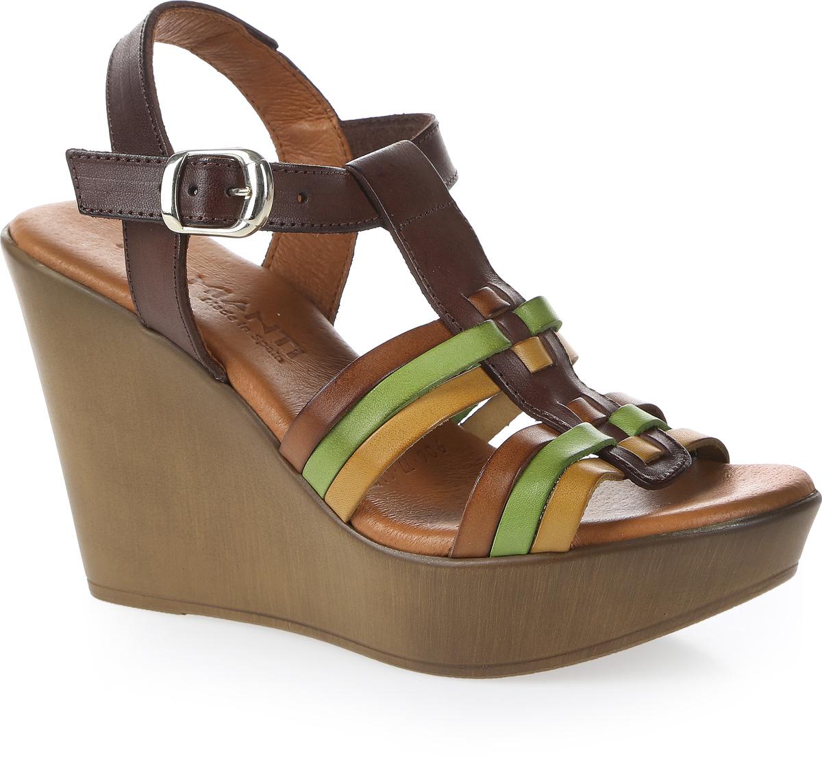 Босоножки женские Mia Mianti, цвет: коричневый, зеленый. 906-77-01/83. Размер 38906-77-01/83Удобные босоножки от Mia Mianti - незаменимая вещь в гардеробе каждой женщины. Модель выполнена из натуральной кожи и декорирована поперечными, контрастными ремешками. Ремешок с прямоугольной металлической пряжкой отвечает за надежную фиксацию модели на ноге. Длина ремешка регулируется за счет болта. Стелька из натуральной кожи, дополненная названием бренда, комфортна при ходьбе. Высокая танкеткакомпенсирована платформой. Подошва с рифлением обеспечивает отличное сцепление с любыми поверхностями. Стильные босоножки прекрасно дополнят любой из ваших образов.