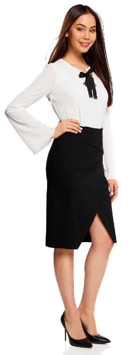 Юбка oodji Ultra, цвет: черный. 14100073/46698/2900N. Размер M (46)14100073/46698/2900NСтильная юбка с диагональным разрезом спереди выполнена из высококачественного трикотажа. зади модель застегивается на потайную застежку-молнию.