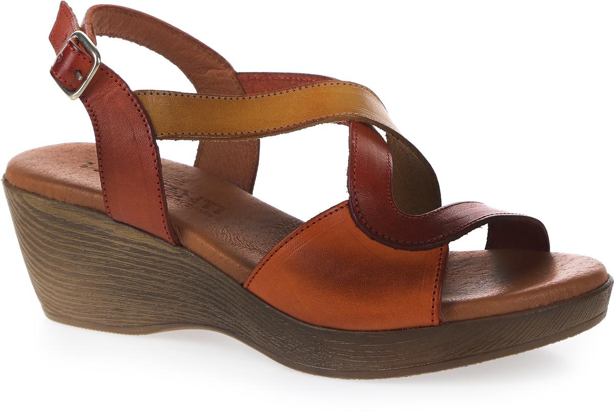 Босоножки женские Mia Mianti, цвет: оранжевый, коричневый. 906-67-01/83. Размер 39906-67-01/83Модные босоножки от Mia Mianti займут достойное место среди вашей коллекции обуви. Модель изготовлена из натуральной кожи и исполнена в двух цветах с изящными ремешками. Ремешок с прямоугольной металлической пряжкой обеспечивает надежную фиксацию модели на щиколотке. Длина ремешка регулируется за счет болта. Стелька из натуральной кожи дополненная логотипом бренда - комфортна при движении. Невысокая танкетка с рифлением защищает босоножки от скольжения. Стильные босоножки - основа гардероба настоящей модницы.
