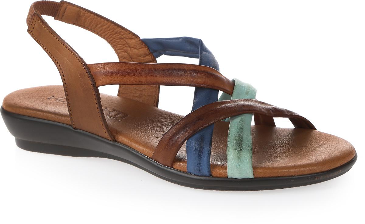 Сандалии женские Mia Mianti, цвет: коричневый, синий. 906-60-03. Размер 36906-60-03Чудесные сандалии от Mia Mianti не оставят равнодушной настоящую модницу. Модель изготовлена из натуральной кожи. Фиксирующие ремешки и резинки на подъеме надежно закрепят изделие на ноге. Стелька, оформленная названием бренда, исполнена из натуральной кожи. Подошва с рифлением обеспечивает идеальное сцепление с любой поверхностью. Стильные сандалии помогут вам создать неповторимый образ.