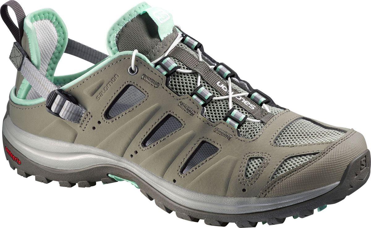 Кроссовки женские Salomon Ellipse Cabrio, цвет: серый. L37955600. Размер 4 (35)L37955600Трекинговые кроссовки Salomon Ellipse Cabrio выполнены из сочетания быстросохнущего синтетического материала, который выглядят как кожа, и сетчатого текстиля. По канту модель оформлена текстильной нашивкой для лучшего прилегания к ноге, по бокам - перфорацией для лучшей воздухопроницаемости. Удобная шнуровка с фиксатором и регулируемый ремешок с пластиковой пряжкой в области пятки гарантируют надежную фиксацию обуви на ноге. Текстильная подкладка и стелька из ЭВА материала с текстильным верхним покрытием обеспечивают дополнительный комфорт и предотвращают натирание. Задник дополнен ярлычком для более удобного надевания обуви, язычок - текстильной нашивкой с символикой бренда, одна из боковых сторон - принтом в виде логотипа бренда. Технология Contagrip обеспечивает надежность сцепления и высокую износостойкость подошвы благодаря продуманной геометрии и плотности протектора. Такие кроссовки отлично подойдут как для занятия спортом, так и для активного отдыха в сырую или сухую погоду жарким летом.