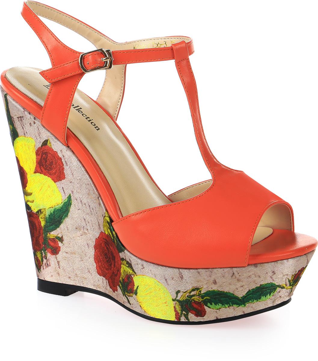 Босоножки женские LK Collection, цвет: оранжевый. W263-7156-3 PU. Размер 35W263-7156-3 PUСтильные босоножки на высокой танкетке выполнены из искусственной кожи. Стелька выполнена из натуральной кожи. Босоножки фиксируются на ноге при помощи застежки-пряжки.