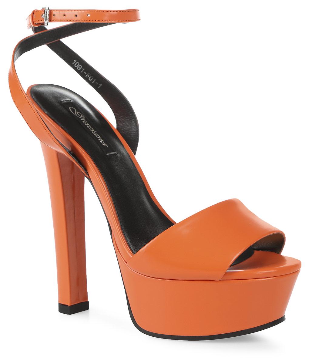 Босоножки женские Graciana, цвет: оранжевый. 1091-F01-1. Размер 361091-F01-1Женские босоножки от Graciana на высоком устойчивом каблуке выполнены из натуральной кожи. Модель фиксируется на ноге при помощи ремешка на пряжке. Подкладка, изготовленная из натуральной кожи, обладает хорошей влаговпитываемостью и естественной воздухопроницаемостью. Стелька из натуральной кожи гарантирует комфорт и удобство стопам. Подошва из резины обеспечивает хорошую амортизацию и сцепление с любой поверхностью.