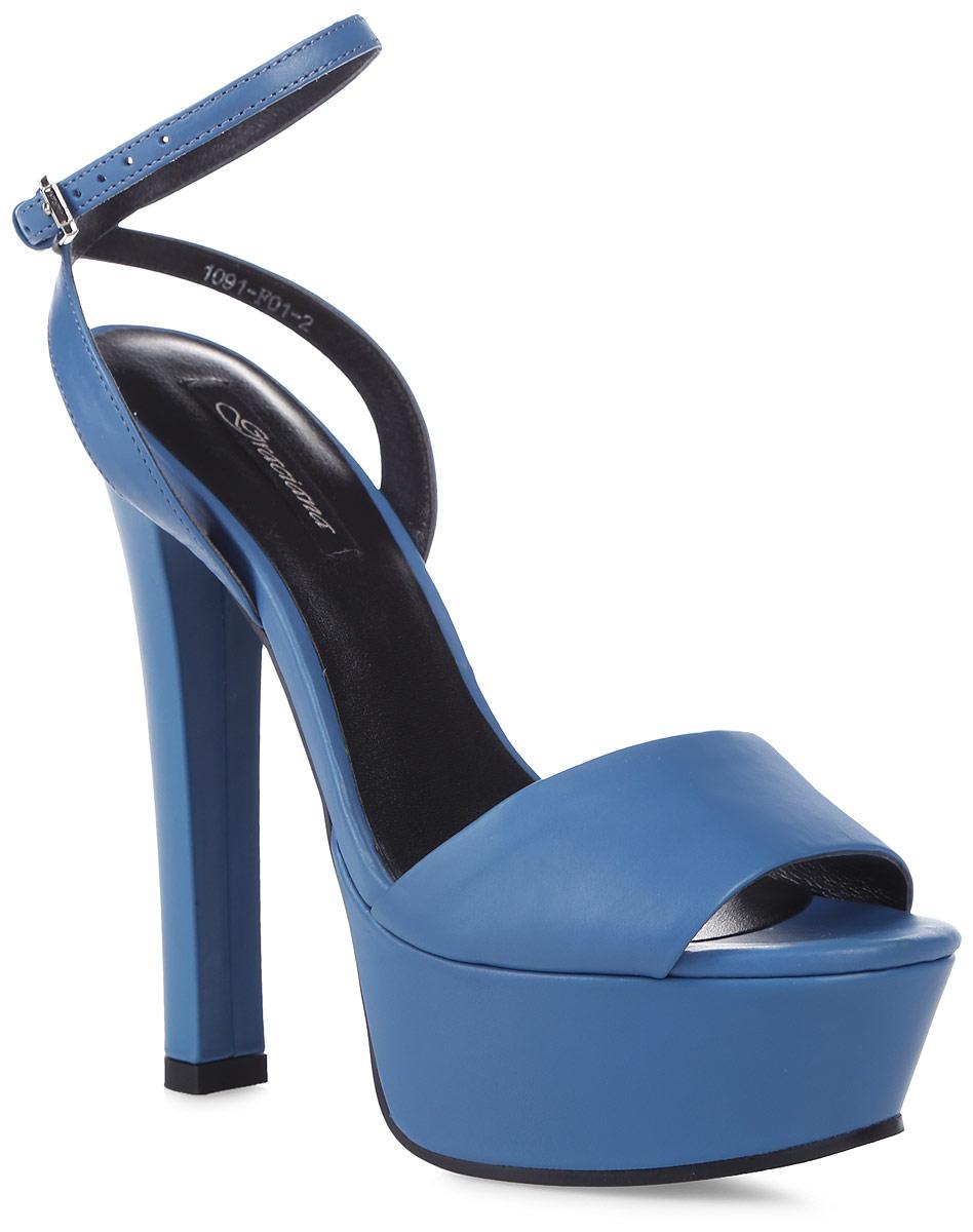 Босоножки женские Graciana, цвет: синий. 1091-F01-2. Размер 371091-F01-2Женские босоножки от Graciana на высоком устойчивом каблуке выполнены из натуральной кожи. Модель фиксируется на ноге при помощи ремешка на пряжке. Подкладка, изготовленная из натуральной кожи, обладает хорошей влаговпитываемостью и естественной воздухопроницаемостью. Стелька из натуральной кожи гарантирует комфорт и удобство стопам. Подошва из резины обеспечивает хорошую амортизацию и сцепление с любой поверхностью.