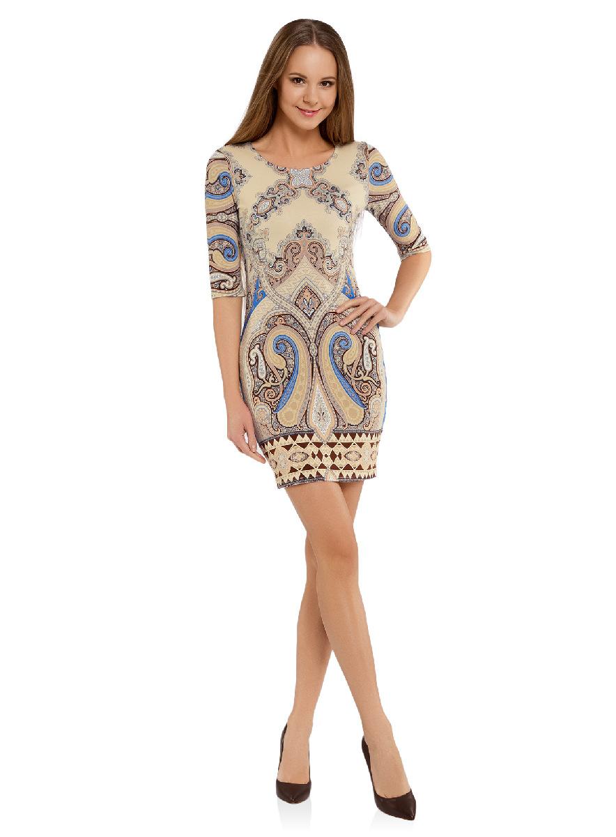 Платье oodji Ultra, цвет: бежевый, синий. 14001121-2B/14675/3375E. Размер XS (42-170)14001121-2B/14675/3375EОблегающее платье oodji Ultra выполнено из качественного трикотажа и оформлено оригинальным принтом в этническом стиле. Модель мини-длины с круглым вырезом горловиныи рукавами средней длинывыгодно подчеркивает достоинства фигуры.